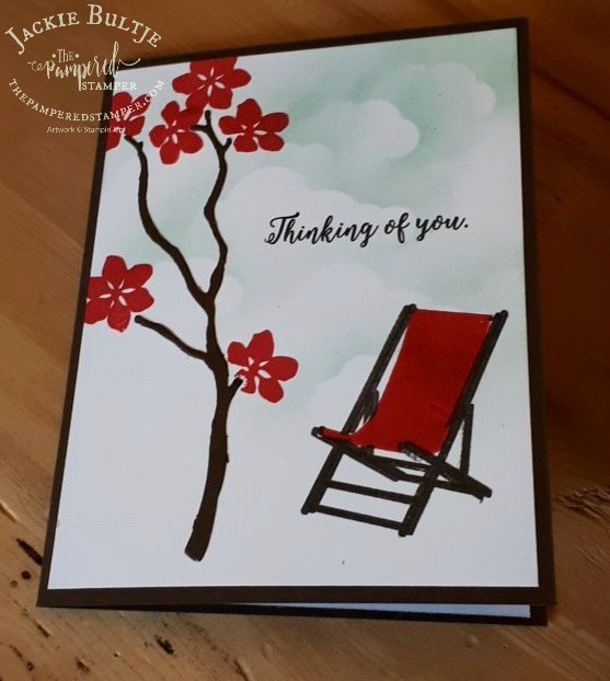 Super simple card with background sponging to make clouds and a pop of red with the chair and the flowers. the branch is a die from Seasonal Layers.