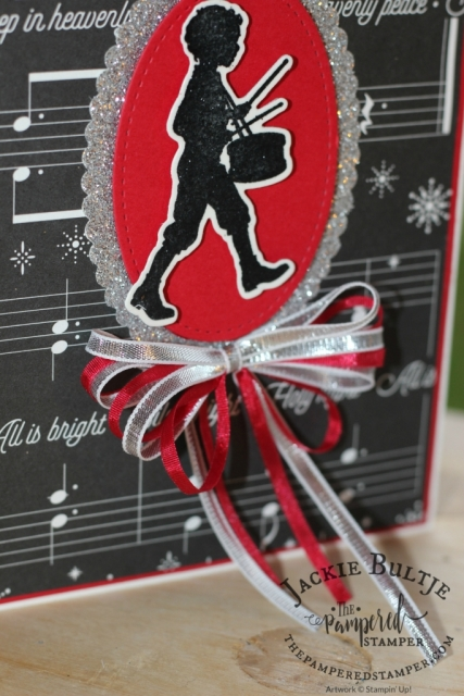 "1/8"" real red ribbon and 1/8"" silver ribbon join forces to make a beautiful triple bow with the Musical Season drummer boy."