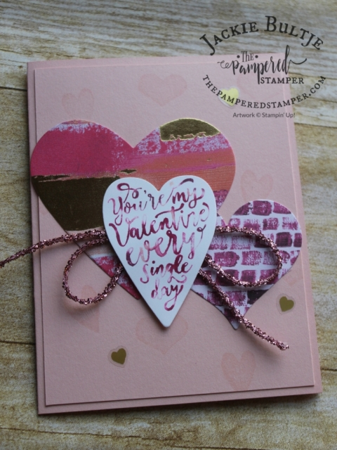 "I used a baby wipe and reinker to create an ""ink pad"" to make the multi coloured sentiment on this pretty Valentine's Day card."