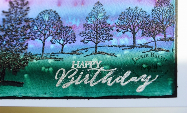 Lovely as a tree embossed in black on Brusho watercolour background