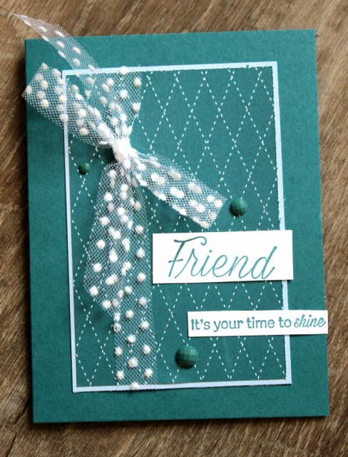 In Color patterned paper and polka dot tulle ribbon are the focal point of this pretty peacock card.